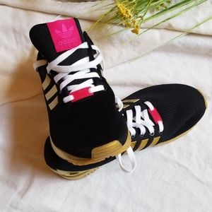 "Adidas ""one of a kind"" Tennis Shoe Size 8"